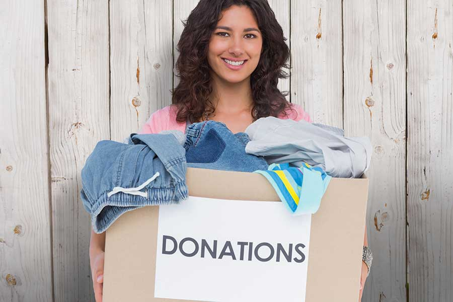 woman holding box for donation