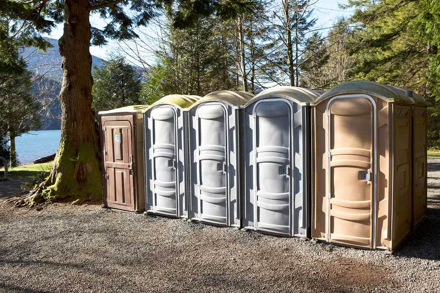 row of portable toilets in nature